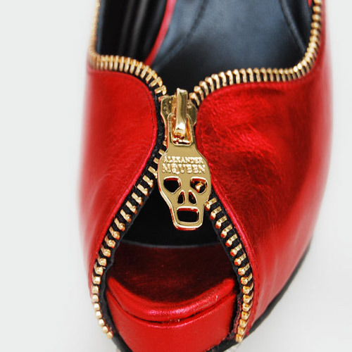 Alexander McQueen metallic red leather peep-toe pumps with gold skull zipper details.