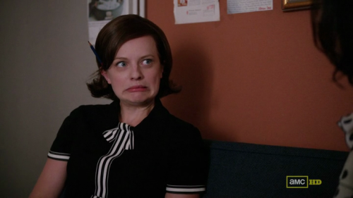 Mad Men's Peggy Olsen suddenly becomes aware of the pencil tucked behind her ear. Editor's note: either that or it's some kind of brain leech from a B-movie. Submitted by Joannes.