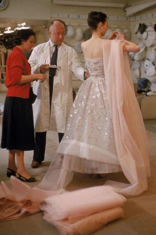 amandapearly:  The Dior eye Christian Dior adjusting a dress on a model in his Paris salon as he readied his collection for a show, February 1957