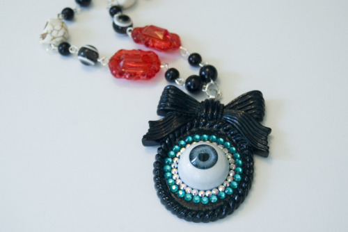 starchildbysaffron:  No less than three new eyeball cameo necklaces are up in the shop! Go check 'em out, kids!
