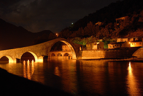 This is a Devil Bridge in Italy.  Legends says that in the middle ages, all around Europe the Devil appeared and promised to built a bridge if he had in exchange the first soul that crossed. After it was built, the humans beat the devil at his own game, sending a goat, a pig, a dog, a cat or a  rooster to make the maiden crossing (a different animal was sent in each bridge). Europe has around 20 devil bridges, Italy has the most. Can't wait to see one!