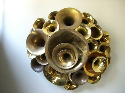 "unconsumption:  ""Junk sculptor"" Leo Sewell's ""Blast,"" made from the bells of various musical instruments. More musical instrument repurposing here."