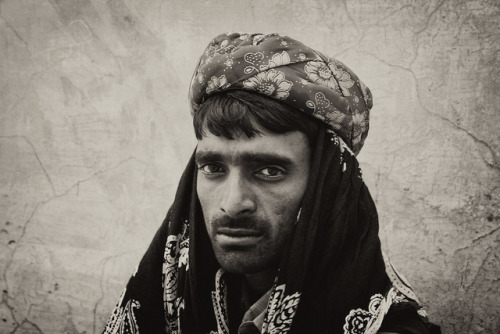 Snake charmer, supporting cast on Flickr. Canon EOS 500D, 55mm, f/8, 1/60, ISO 800 This man was helping a local snake charmer to perform his show, in the Amer Palace, near Jaipur. I sat next to them them during their performance and after tipping them, they briefly posed for a couple of shots.