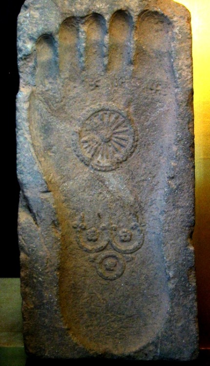"""Footprint of the Buddha with Dharmachakra and triratna, 1st century CE, Gandhāra"""