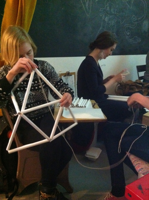 "The class was called ""Polyhedra or structures of the Universe? Let's make mobiles!"" Here we are making our mobiles…."