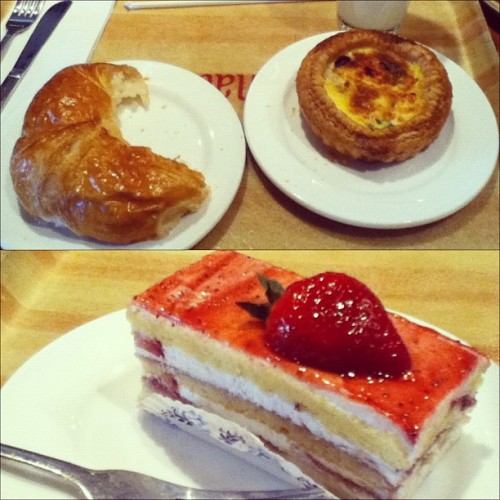 For lunch at the French restaurant, I had a chicken quiche and a croissant and for dessert some kind of strawberry and whipped creme cake, the bottom of it was white chocolate  #food #French #lunch #dessert #cake #pastry # yummy (Taken with instagram)