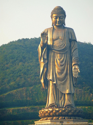buddhazen101:  This statue of Vairocana Buddha was built as China's response to the destruction of the Bamiyan Buddhas by the Taliban in March of 2001.  The Bamiyan Buddhas were one of the largest rock statues ever built in the ancient world. However, the good news is that after 6 years, China was able to at least construct what is now the tallest statue in the world! If you pay close attention to the photo, even the tallest people don't even reach past the toe of the Buddha!  It is measured to be about 420 ft. tall! For more info, you can always check the wikipedia article on this statue of Vairocana (known as the Spring Temple Buddha), and also more about the Bamiyan Buddhas.