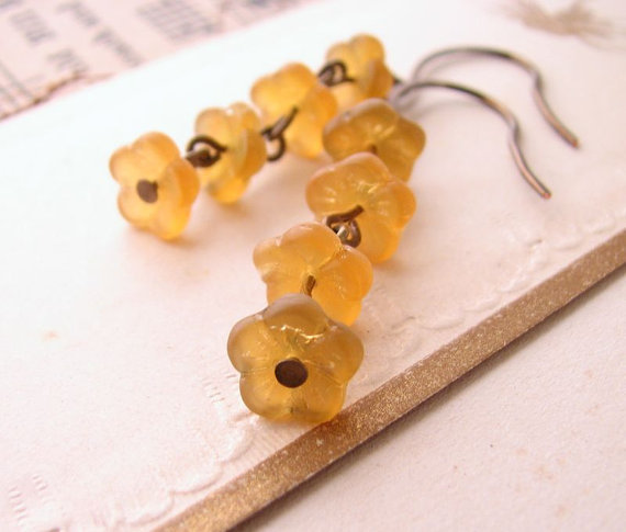 (via Golden Topaz Czech glass flower earrings by shadowjewels on Etsy)