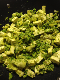 Dinner tonight: Extra firm organic tofu, broccoli, artichoke hearts, pesto, and Parmesan served over pasta.