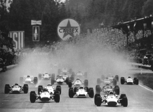The noisy start of the 1968 Belgian Grand Prix. Bruce McLaren took 1st place, and only 5 of the 23 cars that started managed to reach the finish line.