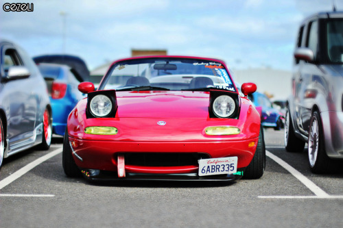 Random Snap Car: Mazda MX5, Miata, Eunos Location: Larne, N. Ireland Story: I photographed this Mazda at a local car show in Northern Ireland early last year. Probably one of my first photos taken with my DSLR. I love the low styling and the Cali number plate is one of those nice touches.