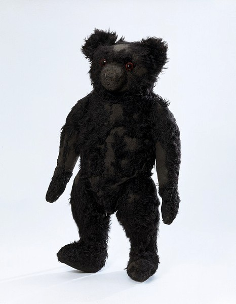 Black teddy bear from England, ca. 1910. From the V&A Museum:  This teddy bear's name is Blackie, for obvious reasons. It is an early English bear and may have been made to commemorate the death of Edward VII. Black is not a very common colour for teddy bears and is usually associated with a tragic event.