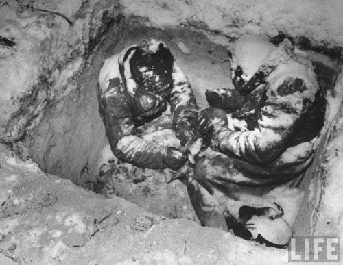 theossuary:  Carl Mydans: Two Russian infantrymen frozen to death in their foxhole. Finland, 1940. Source: LIFE Photo Archive, hosted by Google.
