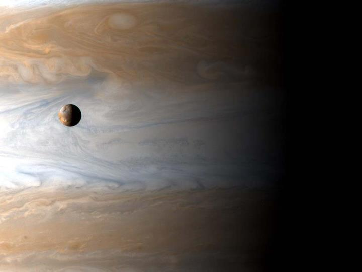 "Moon Io gliding past planet Jupiter. The most volcanic body in the solar system, Io (usually pronounced ""EYE-oh"") is 3,600 kilometers in diameter, about the size of planet Earth's single large natural satellite. The Cassini spacecraft captured this awe inspiring view of active Io with the largest gas giant as a backdrop, offering a stunning demonstration of the ruling planet's relative size. Although in the above picture Io appears to be located just in front of the swirling Jovian clouds, Io hurtles around its orbit once every 42 hours at a distance of 420,000 kilometers or so from the center of Jupiter. That puts Io nearly 350,000 kilometers above Jupiter's cloud tops, roughly equivalent to the distance between Earth and Moon. The Cassini spacecraft itself was about 10 million kilometers from Jupiter when recording the image data."