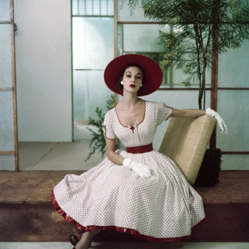 vintageandvictoriana:  Givenchy white tea length dress with red trim and polka dots; white satin gloves; and red wide-brimmed hat. Circa 1952.