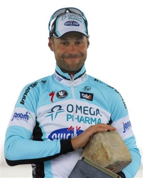 Paris-Roubaix 2012 A very proud Tom Boonen cradles his cobble. (via Photo from AP Photo)