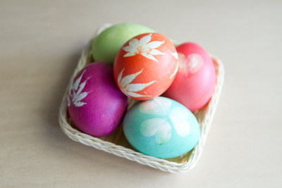 Leaf print Easter eggs dyed with regular ol' food coloring. Leaves held to eggs with egg white and nylons.