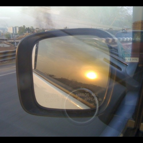 Sunset from rearview mirror,Coming back from today's journey!! #sunset #mirror #car #marutisuzuki #igers #igersindia #Ahmedabad #India #instahub #Instagramhub #instagood #instasunset #photooftheday #picoftheday #sun #pharmasage #pollution #highway #tired #igersindia (Taken with Instagram at S.G. Highway)