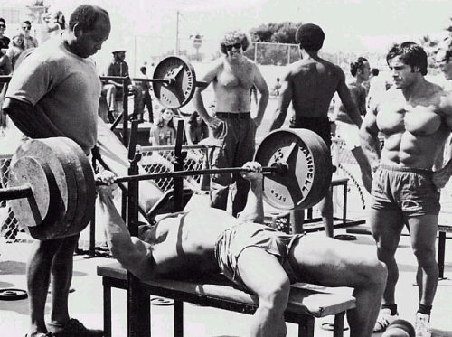 Classic Muscle Beach. Arnold benching, Franco watching.