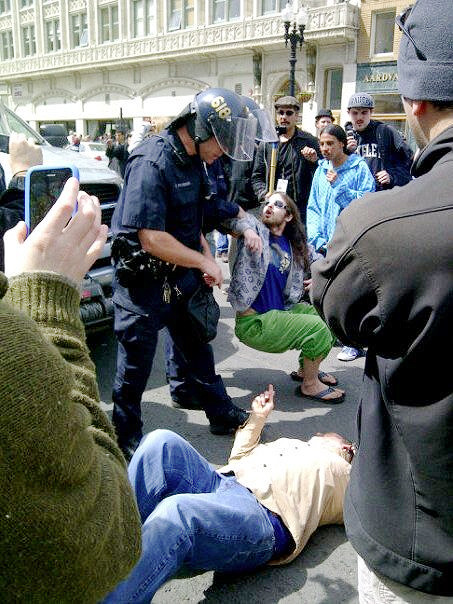 (photo Geoff Ozzy Wright) Oaksterdam DEA Bust April 2, 2012 Protesters laid down in the street to prevent the DEA from taking Prop 19 mastermind Richard Lee's possessions from Oaksterdam University, Oakland, CA via LA Times: Feds raid medical cannabis school in Oakland Federal agents descended early Monday on Oaksterdam University — California's first cannabis industry training school — securing the downtown Oakland facility as they served search warrants. See full story  Related articles Oaksterdam Founder, Prop. 19 Funder, Driven Out of His Peaceful, Productive Business by Government (reason.com) Oaksterdam University Founder To Hand Over Ownership Following Raids (sanfrancisco.cbslocal.com) Oaksterdam founder to leave cannabis business (mercurynews.com)