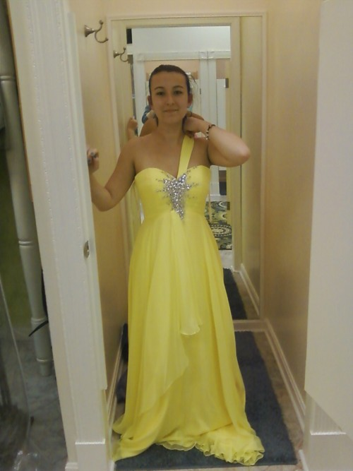 So, this is the prom dress I got, even though my prom is more than a month away! Ignore my face and such, but I know one of my friends on here wanted to see it, so I figured I'd show everyone :)