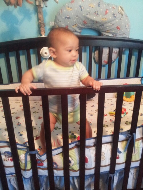 Riley standing in his crib: 5 months old.