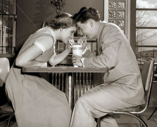 theniftyfifties:  A young couple at the Malt Shop, 1950s.