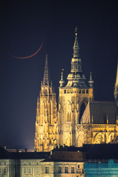 ikenbot:  Prague Castle Crescent by David Tschorn 1 day old moon setting behind the Prague castle on March 24th.