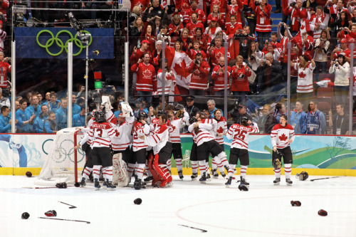 Celebrating our glorious victory over the USA at the 2010 Winter Olympics. To cheer me up after yesterday's devastating loss.
