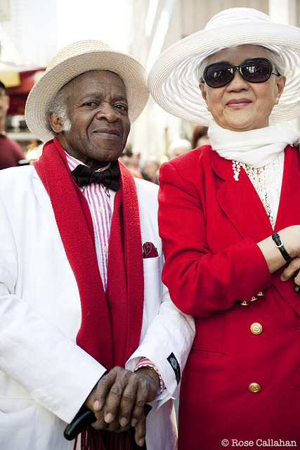 Older couple at the Easter Bonnet Parade photographed by Rose Callahan in NYC on April 8, 2012