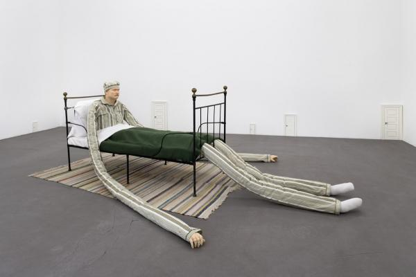 byeguy:  Untitled (Man in bed, small doors), 2006Oil paint on fiberglass cast, painted wood, and mixed materials by Peter Land