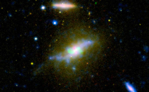 "The Beginning of the End of Star Formation Time is running out for the galaxy NGC 3801, seen in this composite image combining light from across the spectrum, ranging from ultraviolet to radio. NASA's Galaxy Evolution Explorer and other instruments have helped catch the galaxy NGC 3801 in the act of destroying its cold, gaseous fuel for new stars. Astronomers believe this marks the beginning of its transition from a vigorous spiral galaxy to a quiescent elliptical galaxy whose star-forming days are long past.  Visible light from the Sloan Digital Sky Survey is seen in yellow shining from all of the galaxy's stars. Notice that NGC 3801 is starting to possess a broadly elliptical shape, the characteristic shape a galaxy assumes after forming from a merger of spiral galaxies. Some star formation is still taking place in NGC 3801, as shown in the ultraviolet by the Galaxy Evolution Explorer (colored blue), and in the dusty disk revealed in infrared light by NASA's Spitzer Space Telescope (red).  According to theory, that lingering star formation will soon be quenched by shock waves from two powerful jets shooting out of NGC 3801's central giant black hole. Radio emissions from those jets appear in this image in green. Like a cosmic leaf blower, the jets' expanding shock waves will blast away the remaining cool star-making gas in NGC 3801. The galaxy will become ""red and dead,"" as astronomers say, full of old, red stars and lacking in any new stellar younglings.  Near-ultraviolet light from the Galaxy Evolution explorer at a wavelength of 230 nanometers is rendered in blue, while visible light at 469 nanometers from Sloan is displayed in yellow. Infrared light at 8 microns from Spitzer is red, and radio emission at 20 centimeters from NRAO's Very Large Array is overlaid in green.  Image credit: NASA/JPL-Caltech/SDSS/NRAO/ASIAA  Awesome galaxy is awesome. :D"