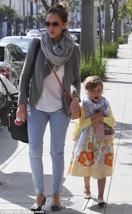 Celebrity Scarf Watch: Jessica Alba in a grey marl scarf with her daughter Honor in a striped blue scarf. Honor's scarf is similar to this Scarf Envy scarf.