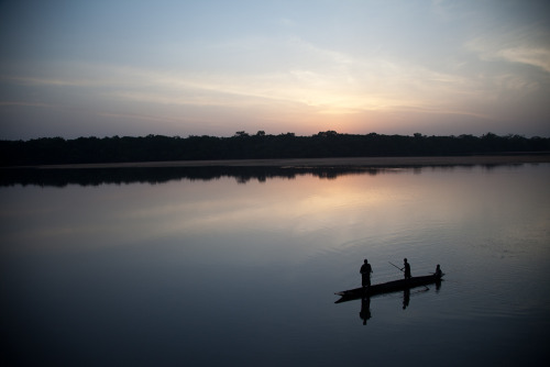 Pirogue at dusk, the Sangha River, Central African Republic - seen from the terrace at Doli Lodge, just outside Bayanga.