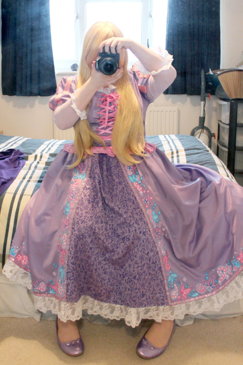 iggie39:  Ok! So My 'Punzel dress is pretty much finished~! I'm sorry about the bad photo like usual T_T (and that I'm sat down again…the mirrors too close to the bed to actually stand and get everything in -_-)  I'm still a little iffy about parts…the tops a little too big on me…and the ribbon on the front and the lace along the bottom a little more vibrant than I'd like but I have no time to go out to grab some more and I can't stand painting the lace again! T_T Wigs still need styling (There's 3 of them to work with fff) but hopefully we can do that today <3 but other than that it's all done!  I've changed my opinion completely over the skirt…I'm super proud of it now…and the responses I've got from you guys on Tumblr has been just…amazing thank you so much <3 Hopefully I'll get some nice photos of this at Kita .///.  MY IGGIIIEEE <3 YOU PERFECT CUTIE CREATURE. It looks incredible, I'm so proud of you~! <3 Can't wait to tackle the wig today, I just hope I can do a good enough job!
