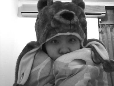 at the moment wearing bear headpiece and double sized blanket.