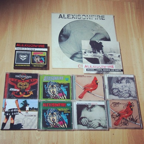 smileforthecamerasweetheart:  Say hello to mine and @haggaz alexisonfire collection (Taken with instagram)  mmmm want the signed cds, my Watch Out! is signed :)