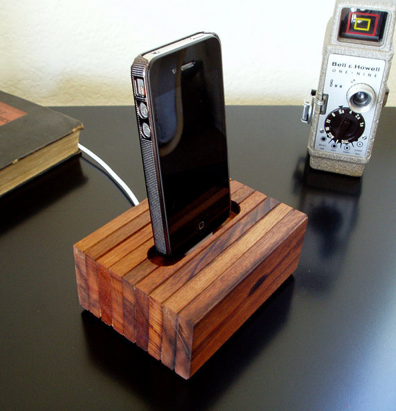 iPhone 4 Cradle Reclaimed Wood iPhone Charger w/o by iCreateWorx Each cradle is handcrafted from reclaimed Brazilian Hardwood, and each has it's own unique look. This cradle will fit your iPhone 4 as well as 3G and 3GS. It is designed to charge and sync while your case is on the phone. An added benefit to the cradle design is increased sound.