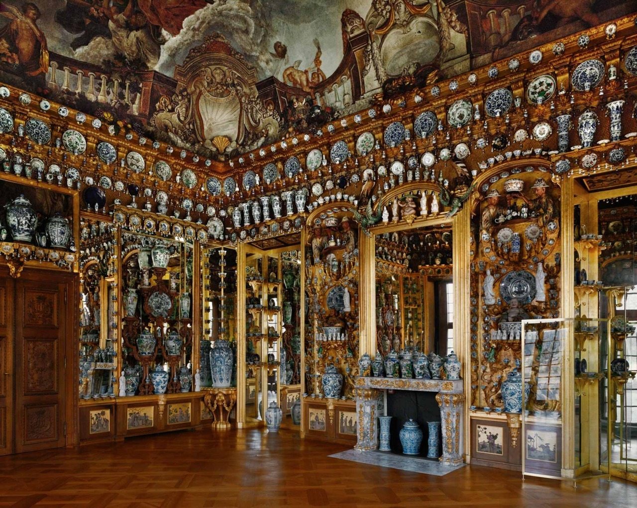 "The ""Porcelain Chamber"" in Charlottenburg Palace, Berlin, completed in 1706. The greater availability of Chinese and Japanese porcelain from the mid-1600s onward increased interest in this material. Nobles throughout Europe collected porcelain and created ""China cabinets""—rooms completely decorated with ceramics displayed on brackets, mantelpieces, shelves, and sometimes even on the floor."