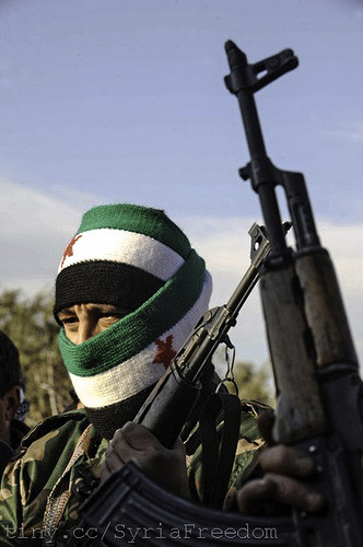 "Financial Times: Syrian opposition wary of jihadist push ""Jihad is the only way to avenge the killing of our brothers,"" says the narrator as the camera zooms in on roadside bombs taking out Syrian security vehicles.  FULL ARTICLE (Financial Times) Photo: FSA member on patrol in Idlib, FreedomHouse/Flickr"