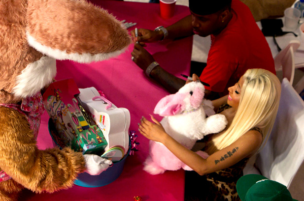 April 7: Nicki Minaj meets the Easter bunny during her album signing for 'Pink Friday: Roman Reloaded' in Culver City, California.