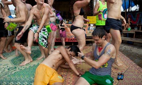 "Vang Vieng is the planet's most improbable party town. Located deep in central Laos, one of southeast Asia's poorest countries, the once-tranquil farming village has become a seething epicentre of backpackers behaving badly. ""God no, you don't come to Vang Vieng for the culture, like temples and stuff,"" laughs a 19-year-old Australian called Louise, who is dancing to a Flo Rida anthem with a beer bottle in each hand at one of the many riverside bars. ""You come here to get wasted."" Half an hour later I spot Louise vomiting over her sparkly flip-flops before passing out. Got it.  Those philosophical RTW travelers truly are better people than the rest of us."