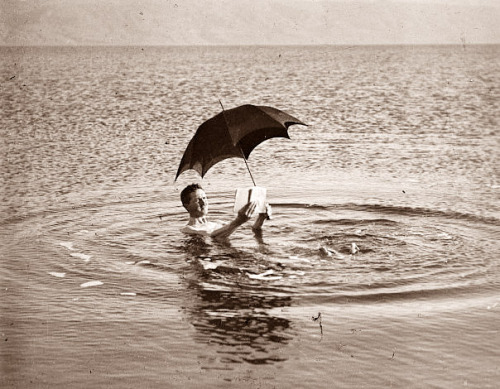 a man floating in the dead sea, 1910s