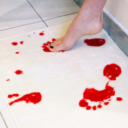 uselessheartache:      Bath mat turns red when wet.   WHOA  I need towels made out of this, and then I'd make my guests use them with out telling them. Then wait for the screams of terror.