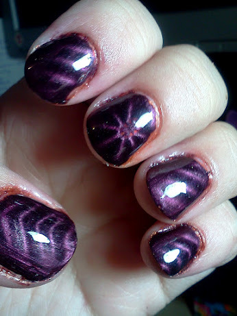 China Glaze Iron Cross under China Glaze Magnetix Instant Attraction. The subtle orange coming through under the purple is much easier to see in real life. If trying this again I would probably use a lighter magnetic polish.