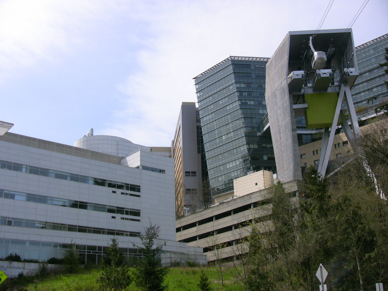 OHSU and the Portland Aerial Tram's upper terminal from Terwilliger Blvd.
