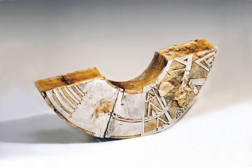 "Patricia Sannit: Cradle, 2010, 21""x32""x12"", hand-built, carved and incised reclaimed clays, slip and stain"