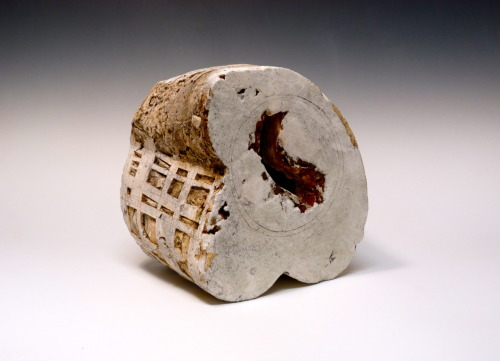 "Patricia Sannit: Eroded Poles, 2012, 12""x9""x11"", cast, carved and incised found and reclaimed clays, slip and stain"