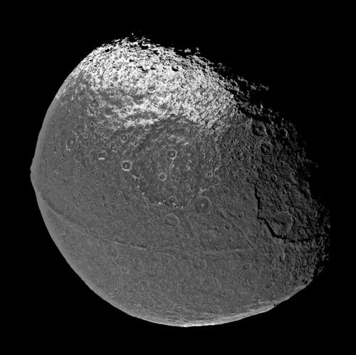 "thenewenlightenmentage:  Mystery of Saturn's Walnut Moon Cracked? The giant ridge around the middle of Saturn moon's Iapetus that makes it resemble an oversize walnut may have essentially formed as a ""hug"" from a dead moon, researchers say. Iapetus, the third-largest of Saturn's moons, possesses a mountain range like no other in the solar system. This enormous ridge wraps along its equator, reaching up to 12.4 miles (20 kilometers) high and 124 miles (200 km) wide, and encircles more than 75 percent of the moon. Altogether, the ridge may constitute about one-thousandth the mass of Iapetus. ""I would love to stand at the base of this wall of ice 20 kilometers tall that heads off straight in either direction until it dips below the horizon,"" study lead author Andrew Dombard, a planetary scientist at the University of Illinois at Chicago, told SPACE.com. Scientists had been at a loss to explain how this mountain range might have formed. Of all the planets and moons in our solar system, apparently only Iapetus has this kind of ridge — any process that researchers previously suggested to explain its formation should also have led to similar features on other bodies. [Photos of Saturn's Moons] Now investigators suggest this ridge could be the remains of a dead moon. Their model proposes that a giant impact blasted chunks of debris off Iapetus at the tail end of the planetary growth period more than 4.5 billion years ago. This rubble could have coalesced around Iapetus, making it a ""sub-satellite,"" a moon of a moon. Under this scenario, the gravitational pull Iapetus exerted on this sub-satellite eventually tore it back into pieces, forming an orbiting ring of debris around the moon. Matter from this debris ring then rained down, building the ridge Iapetus now sports along its equator fairly quickly, ""probably on a scale of centuries,"" Dombard said. The researchers suggest that, of all the planets and moons in our solar system, only Iapetus has this kind of ridge because of its unique orbit so far away from Saturn. This made it easier to have a moon of its own — if Iapetus was closer in, Saturn might have tugged Iapetus' moon away, Dombard said. More elaborate computer simulations of this process, from the giant impact to the raining down of debris, are needed to test whether the model Dombard and his colleagues suggested might be how Iapetus' equatorial ridge formed. Such analyses would also help pin down specifics of the idea, such as how long it took the sub-satellite to tear apart. ""My personal intuition suggests it took a half-billion to 1 billion years,"" Dombard said. The scientists detailed their findings online March 7 in the Journal of Geophysical Research-Planets. Image Info: A ridge that follows the equator of Saturn's moon Iapetus gives it the appearance of a giant walnut. The ridge, photographed in 2004 by the Cassini spacecraft, is 100 kilometers (62 miles) wide and at times 20 kilometers (12 miles) high. (The peak of Mount Everest, by comparison, is 5.5 miles above sea level.) Scientists are debating how the ridge might have formed. Image Credit:  NASA/JPL/Space Science Institute"