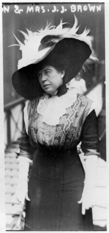 """Molly"" Brown, possibly as she left RMS Carpathia, April 18th, 1912 or 1915.  I can't tell because the listing at the Library of Congress says both.  Her clothing would be outdated for 1915, so I'm guessing the 1912 date is right. Carpathia docked in New York at 9:30 PM EDT on April 18th. If it was taken in 1912, this picture would have been taken by a reporter standing on Pier 54.  Behind him were 40,000 family members and curious onlookers.  Reporters were not allowed on Carpathia or the pilot ship, New York, that guided it into the harbor, but some were able to bribe their way around that rule.  One reporter for the St Louis Post-Dispatch even managed to get onto Carpathia itself as she came through the Hudson Bay and interview a few survivors before literally throwing what he wrote to a nearby tugboat sent by the paper's owner.  Reporters who were more respectful of the rules but still desperate to get their story hovered around the ship in smaller boats and shouted questions. Read more about how the Titanic story evolved in the news here. 100 years ago today, this very minute, Titanic had just slipped under the water. EDIT: This was taken in 1912, but some time after the incident.  Still, what I described is what she would have experienced upon arriving in New York."